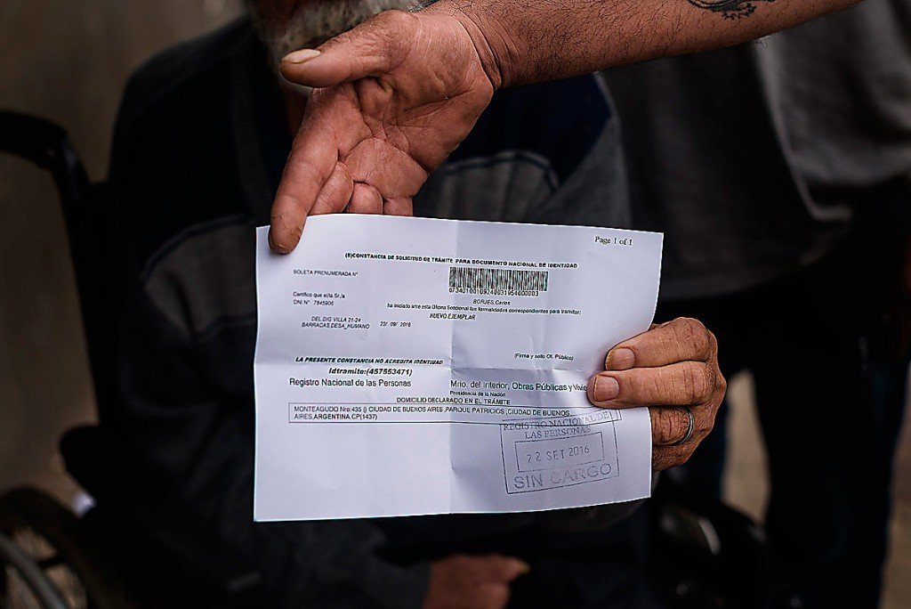 A man holding his friend's ID paper, after that someone steal his belongings.